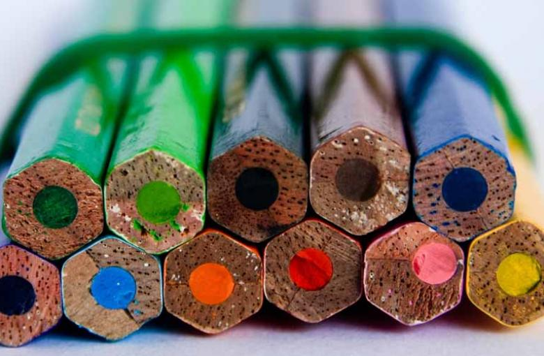 coloured pencils with band